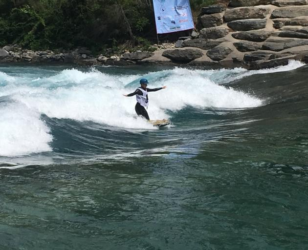 Tapanui's Anna Eade in action at the Hawea Waterpark during the world riverboarding championships...
