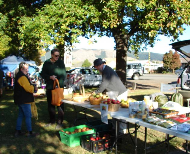Richard Stevens selling some of his apples at Waimate's market. Photo: Supplied
