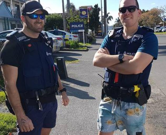 Acting sergeant Rob Eke and Constable Tal Easton still in their togs after nabbing a wanted man...