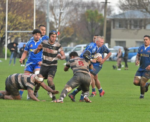 Harbour first five-eighth Logan Allen is tackled by Southern No8 Mika Mafi at Bathgate Park on...