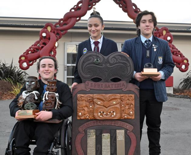 Displaying their well-earned trophies are three of the nga toa whakaihu waka o Nga Manu Korero...