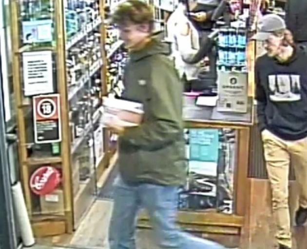 CCTV footage released by Australian police of missing Belgian backpacker Theo Hayez (right, hat,...