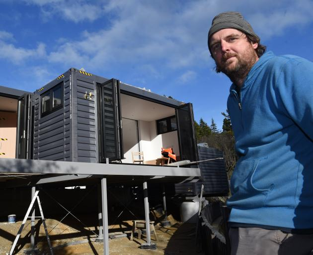Toby Mann at his new Dunedin modular house, delivered 25 hours before this image was taken. Photo: Gregor Richardson
