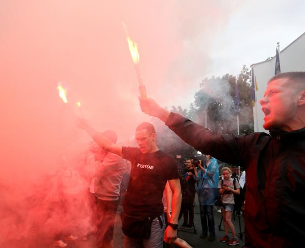 """The death sparked protests outside the Interior Ministry building by people who lit flares and held placards saying """"the police kill people"""". Photo: Reuters"""