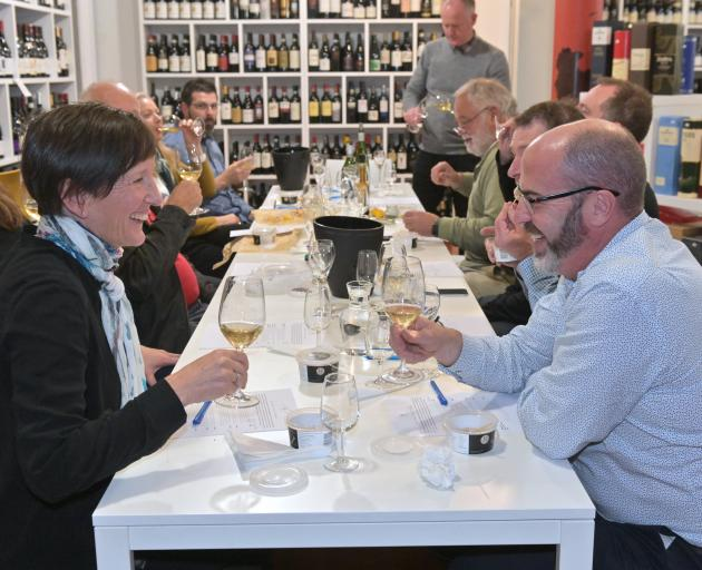 Sue Clarke and Andy Kilsby (foreground) enjoy a wine/oyster matching seminar at Wine Freedom in Dunedin at the end of last month. Photos: Linda Robertson