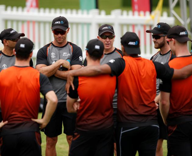 New Zealand players huddle around coach Gary Stead. Photo: Reuters