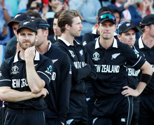 A disappointed Kane Williamson (left) waits with the Black Caps for their medals . Photo: Action Images via Reuters