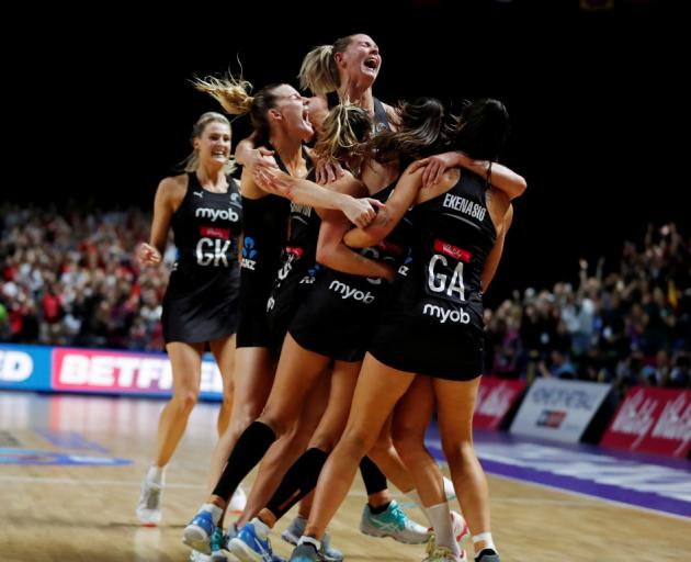Silver Ferns players celebrate their victory in the World Cup final. Photo: Reuters
