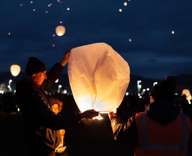 Lanterns are released into the sky.
