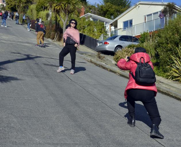 Tourists scale Baldwin St in North Dunedin yesterday. Photo: Gerard O'Brien