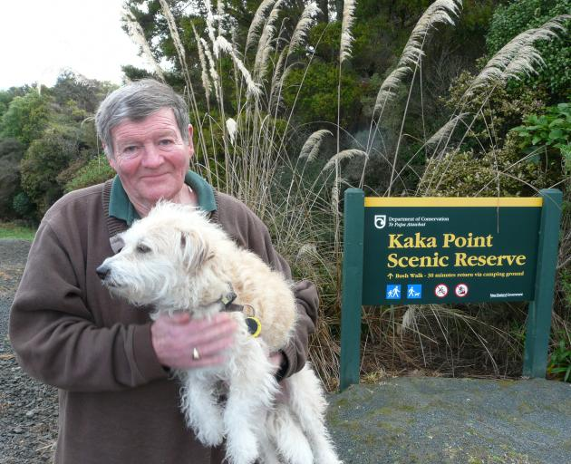 "Kaka Point resident Lyall Butterfield, holding Misha, says the ""urban'' definition of the town in relation to dog registration fees doesn't reflect its ""rural village'' status. Photo: Richard Davison"