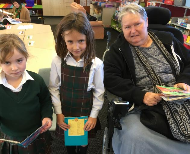 Teacher Jan Willison (right) visits St Gerard's School daily during term time to help children...