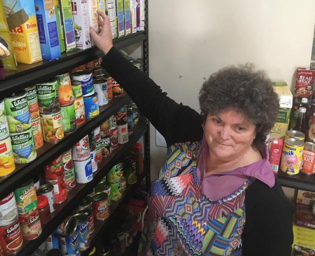Central Otago Budgeting Services office manager/co-ordinator Pam Hughes handles donations of food at the Alexandra Community Pantry. Photo: Alexia Johnston