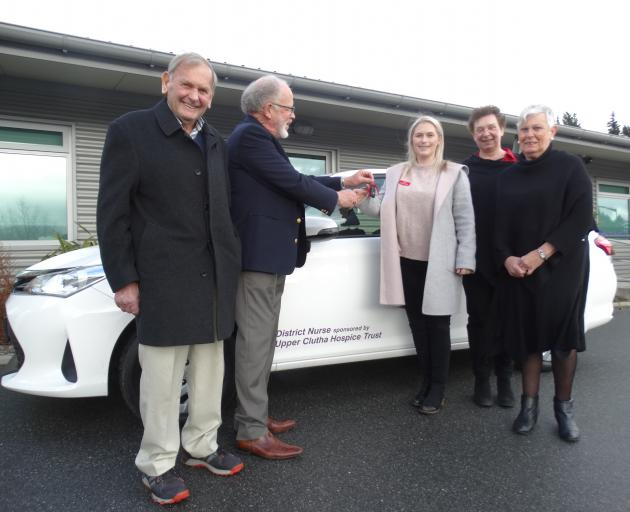 Celebrating the handover of keys for a new vehicle to help deliver palliative services in the Upper Clutha are (from left) Upper Clutha Hospice Trust trustee Neville Dippie, trust chairman Russell McGeorge, Central Otago Health Services Ltd (Cohsl) distri