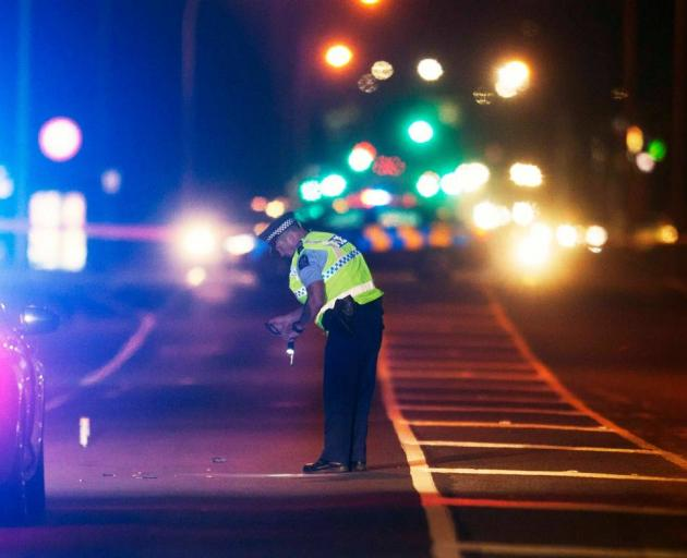 Police investigate the crash scene on Te Ngae Rd where a pedestrian was hit by a car. Photo: NZME