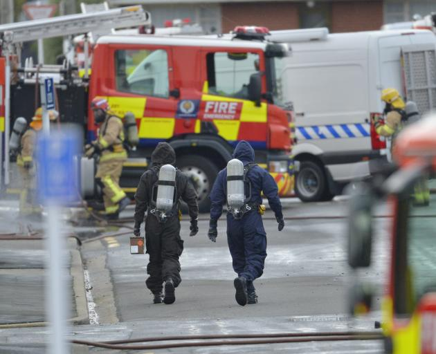 Army explosives experts remove an unstable chemical from a business premise in Glasgow St; South...