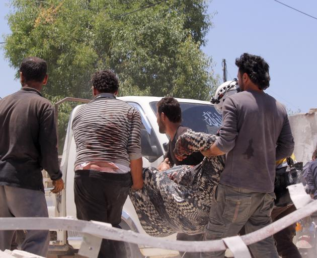 A woman is pulled out of the rubble as civil defence members and locals conduct search and rescue...