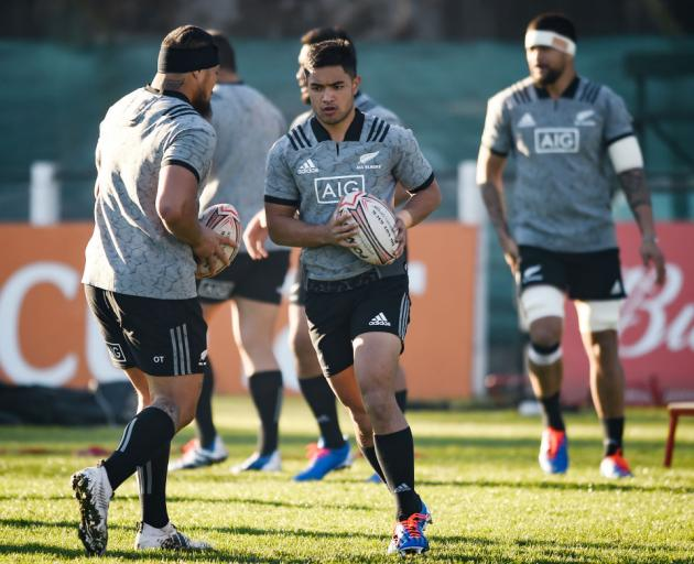 Otago and Highlanders first five-eighth Josh Ioane runs with the ball past Ofa Tuungafasi (left) during an All Blacks training session at San Isidro Club in Buenos Aires yesterday. Photo: Getty Images