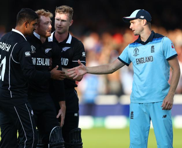 Chris Woakes of England offers his support to Martin Guptill. Photo: Getty Images