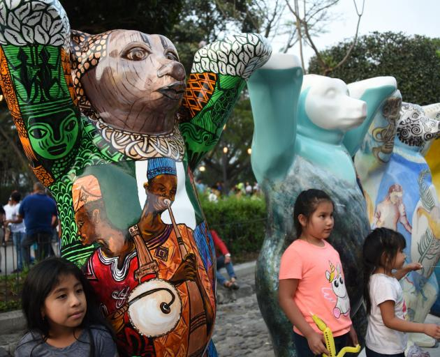 """Guatemalans visit the itinerant exhibition """"United Buddy Bears, the Art of Tolerance"""" at the..."""