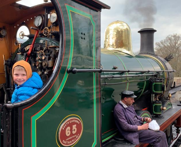 Hugo takes the driver's seat while the engineer takes a break at West Sussex's Bluebell Railway.