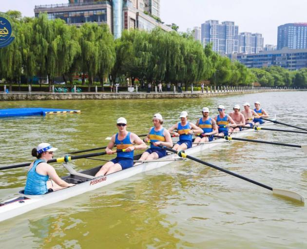 Otago University men's eight rowing team (from left) coxswain Lauren Gibbs, stroke Kyle Hughes, Sam Johnston, Oliver Fahey, Ari Palsson, Corey Lewis, Hayden Bewley, Jared Brenssell and Haxby Hefford warm up for one of their events at the International Fam