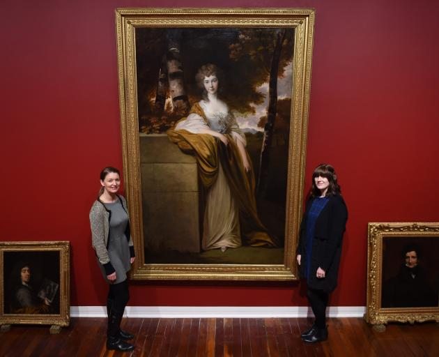 Dunedin Public Art Gallery curators Lucy Hammonds and Lauren Gutsell pictured with one of the large works being set up for ''Style and Substance: A journey through the collection''. Photo: Gregor Richardson