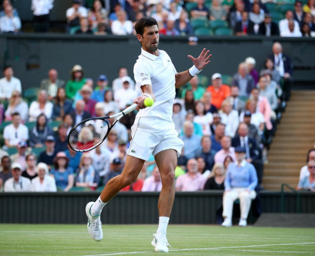Novak Djokovic plays a forehand during his win this morning at Wimbledon. Photo: Getty Images