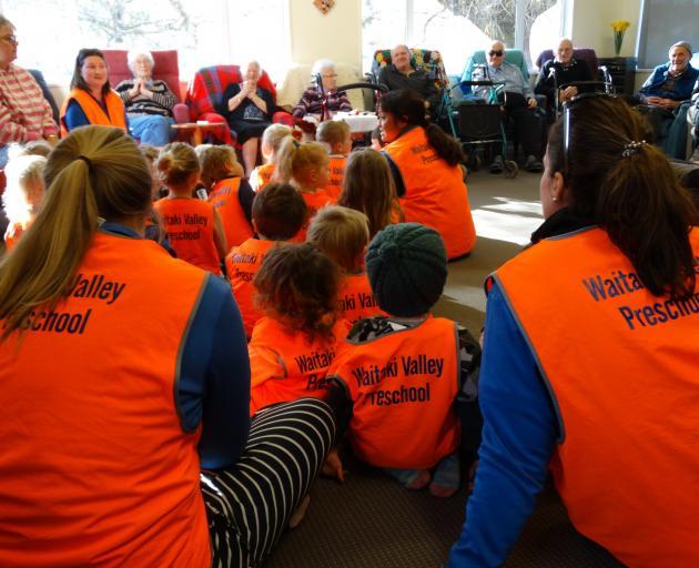 Waitaki Valley Preschool children sing with Whalan Lodge residents.