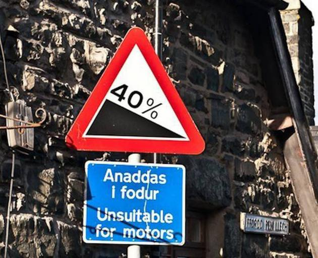 A sign at the top of Pen Ffordd Llech in Harlech, Wales, warns drivers of a slope of 40 per cent ...