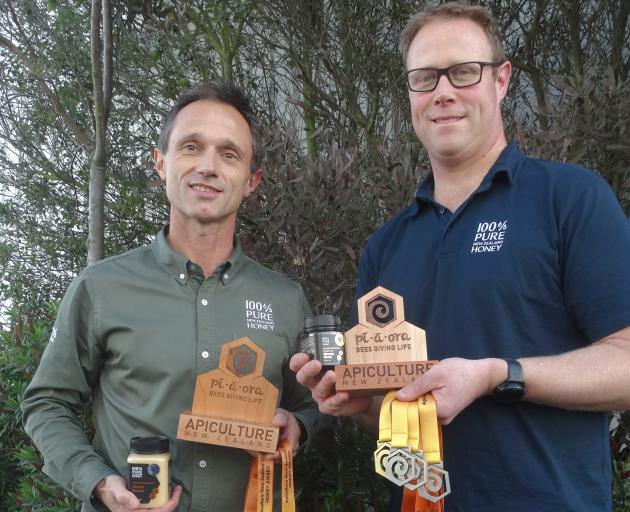 Sean Goodwin (left) and Jarved Allan display the trophies won at the annual Apiculture NZ Honey Awards. Photos: Chris Tobin