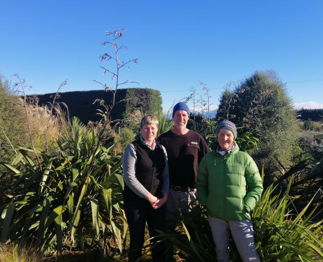 Julie (left), Phil and Helen Wells at their Wrights Rd planting project, which they started five years ago. Photo: Supplied