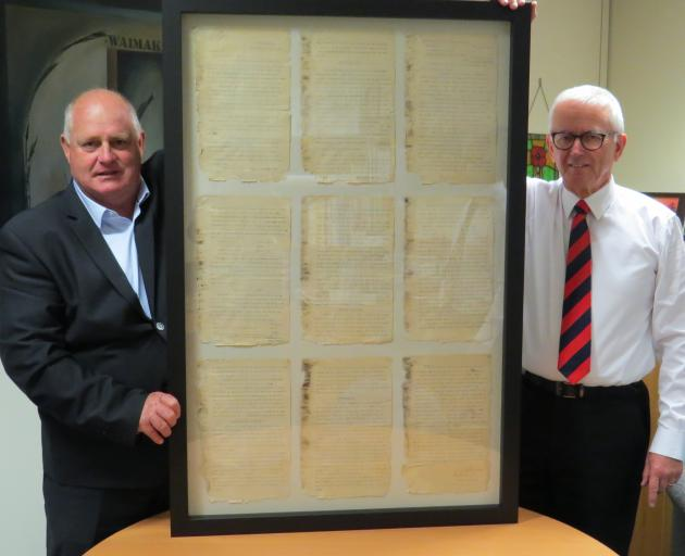 Waimakariri Irrigation Ltd chief executive Brent Walton (left) presents an 1894 report...