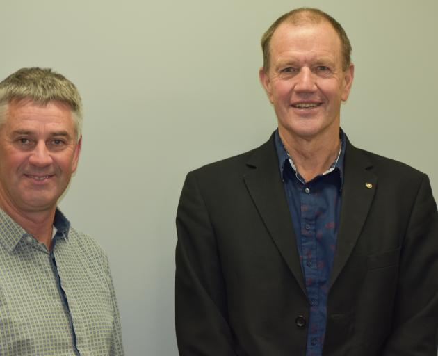 Mark Adams, of Fairlie (left), has taken over from Dave Hewson, of St Andrews, as chairman of the South Canterbury Rural Support Trust. Photo: Supplied