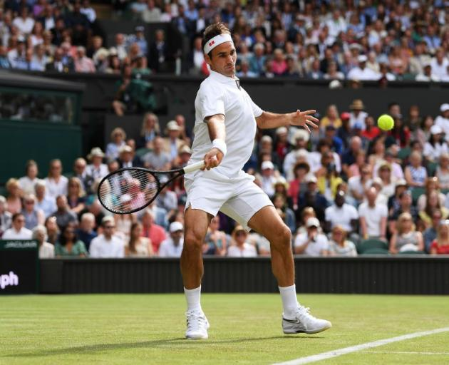 Roger Federer prepares to play a forehand during his first round win at Wimbledon. Photo: Getty...