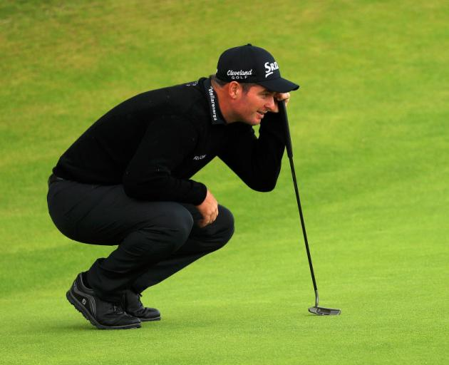 Ryan Fox of New Zealand lines up a putt on the 18th green during the first round of the 148th Open Championship. Photo: Getty Images