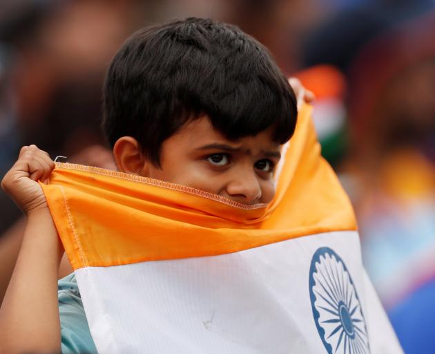 A young India fan can barely watch. Photo: Reuters