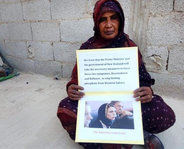 A Saharawi widow, whose husband worked for OCP and whose eight children are all unemployed, holds...