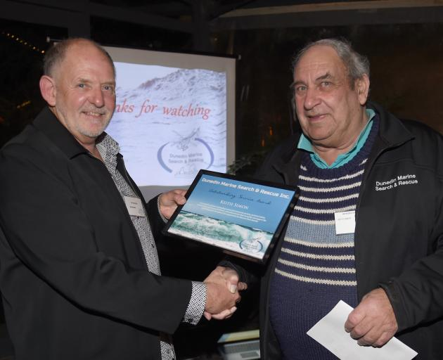 Search and Rescue district co-ordinator Brian Benn (left) presents Keith Simon with an...