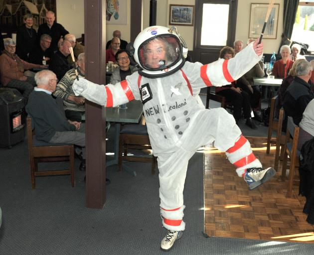 """Donning his homemade """"spacesuit"""" Dunedin man Keith Dickson found a novel way to mark the 50th..."""