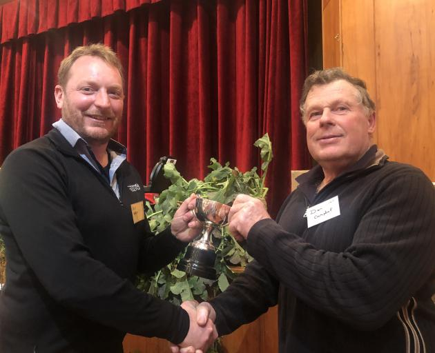 Advance Agriculture's technical field representative for eastern/northern Southland Chris Wilson (left) presented Don Campbell, of Wairuna, with the trophy for winning the swede section of the Clinton Lions Club's brassica competition recently. Photo: Sup