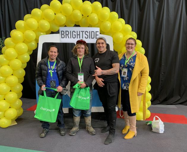 About 120 young farm workers registered for the BrightSide session during the event. From left are Garry Gicaraya, of Woodlands, Brayden Frost, of Benmore, Tangaroa Walker, of Dacre, and Side committee member Amy Johnston. Photo: Courtney Heke-McColgan