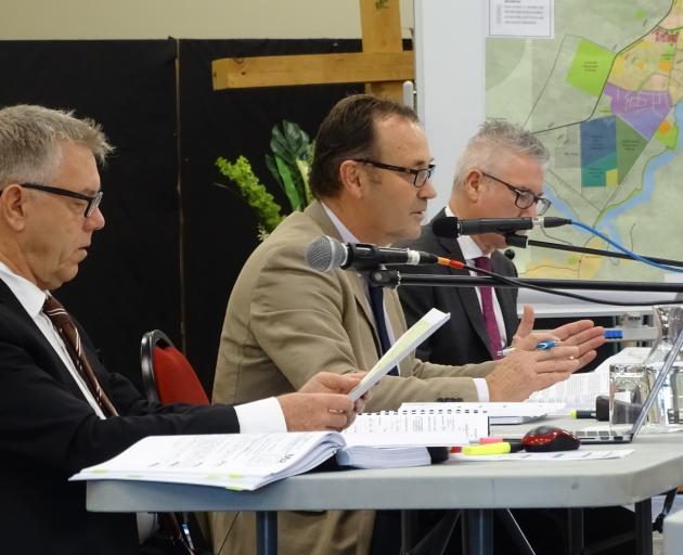 Commissioners (from left) Gavin Lister, Gary Rae (chairman) and David McMahon hearing evidence at...