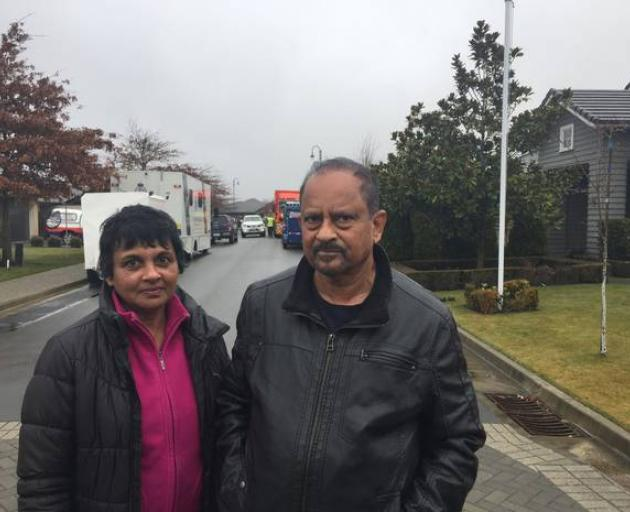 Akita and Indraj Fonsaka who live across the street from the Marble Court, Christchurch house...