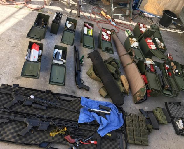 Police seized Illegal high-capacity magazines and an assault rifle along with multiple guns and...