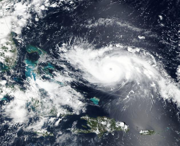 Hurricane Dorian approaches the coast of Florida in this NASA handout satellite image. Photo via...