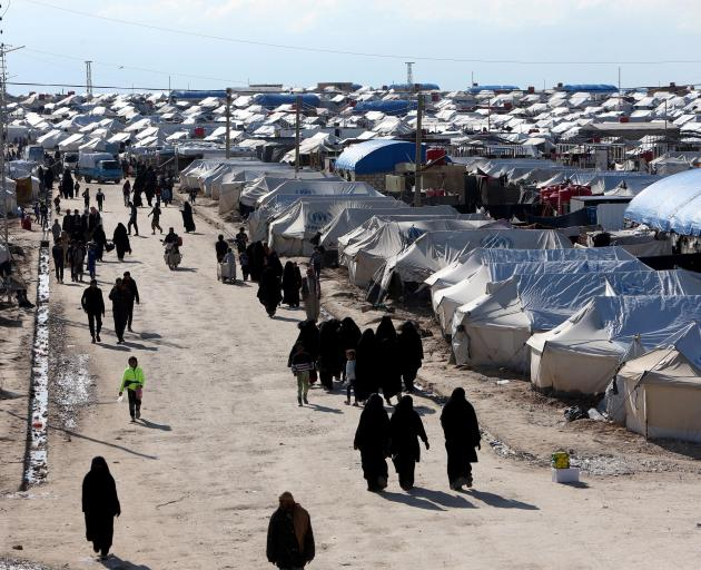 Women walk through Al-Hol displacement camp in Northern Syria. Photo: Reuters