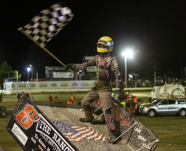 American sprintcar star Buddy Kofoid celebrates his win at this year's NZ Sprintcar Title event...