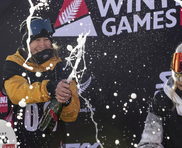 Finland's Enni Rukajarv enjoys the spoils of victory on the podium of the women's Snowboard World...
