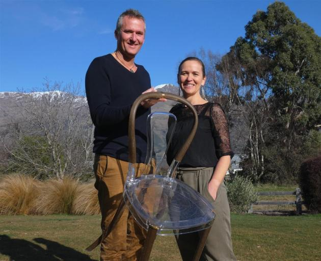 Wanaka couple Alex Guichard and Monique Kelly show the lightweight qualities of their chair made of natural materials. Photo: Simon Henderson
